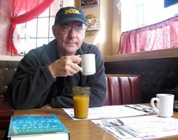 Neil Peart sipping coffee in Littleton, New Hampshire