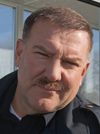 Alex Lifeson as a border guard in <i>Suck</i> - photo courtesy suckthemovie.com