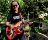 Geddy with his new 1962 Fender Jazz from The Guitar Broker