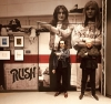 Geddy and Alex in front of their mural at the Rock Hall